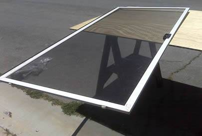 A complete installed window on the board is made of epoxy coated screen.