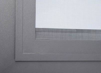 A corner of window made of plastic insect screen.